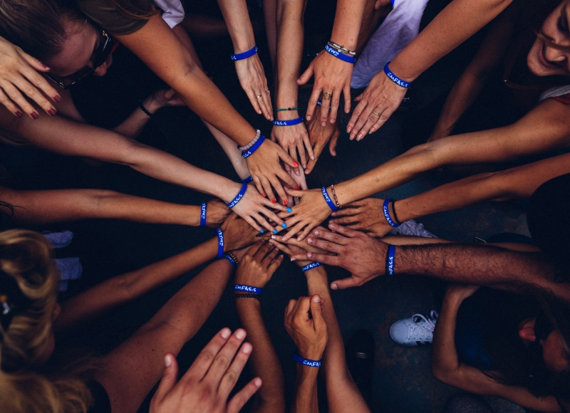 Hands Touching in a Circle