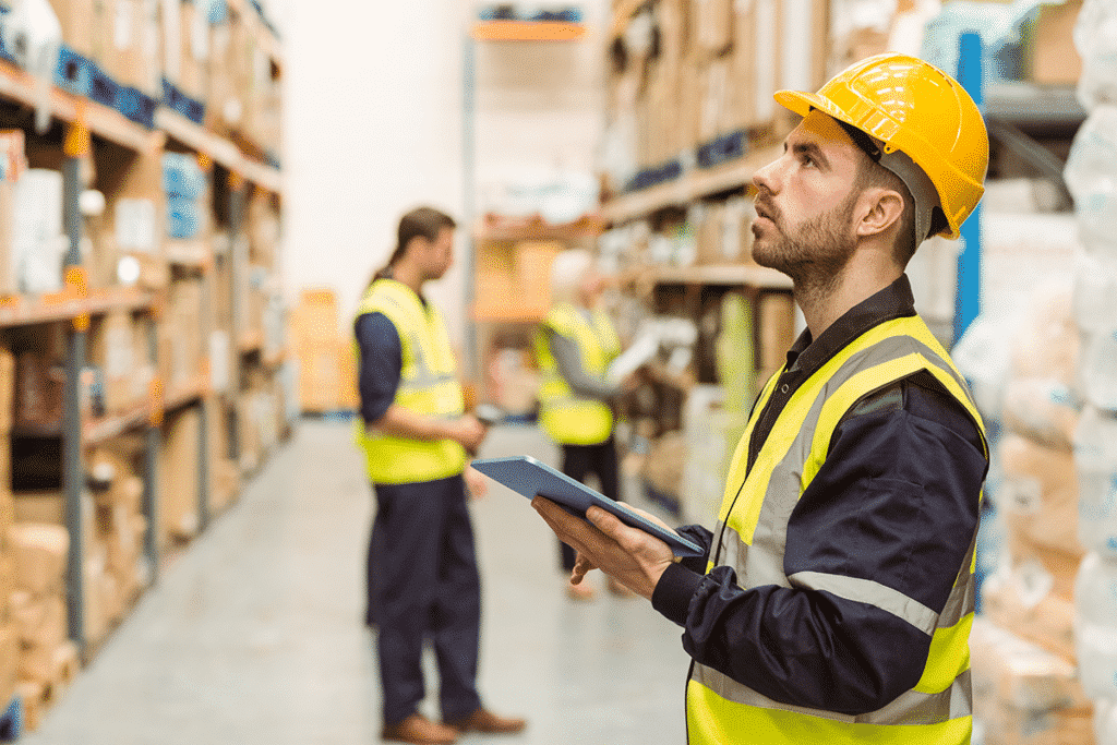 Warehouse working checking inventory from tablet