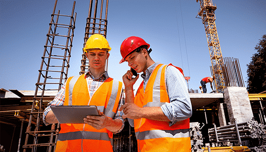 Construction workers using a rugged tablet pc