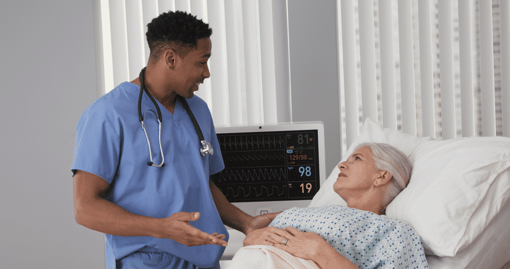 Doctor showing patient charts on panel pc