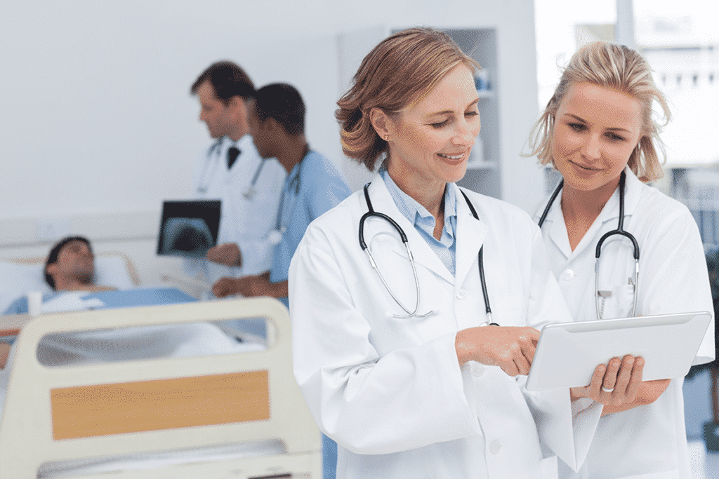 Doctors using a tablet to review patient information together