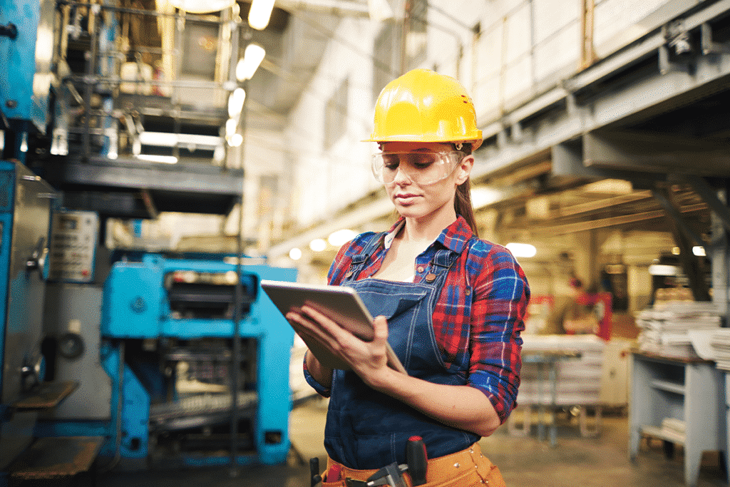 Industrial worker connecting to equipment through wireless technology