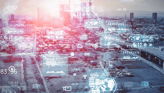 technical charts and graphs overlaying a city to show connected devices everywhere
