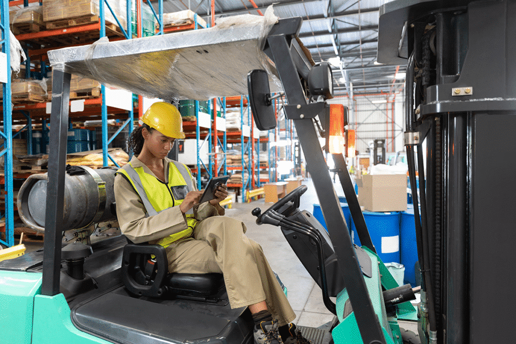 Warehouse worker using tablet to check inventory in a smart warehouse