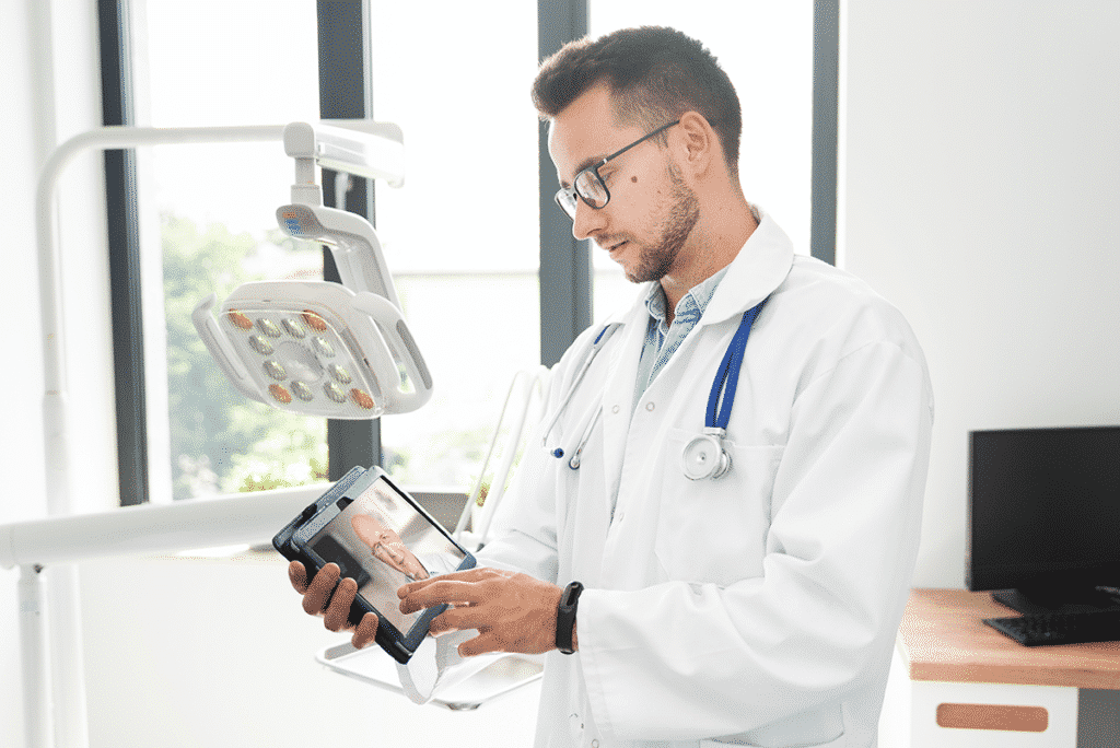 Doctor conferencing with a patient on a tablet